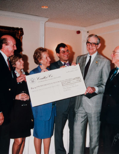 Denis Norden presents a cheque for £12,000 from the Happy Hookers (Golf)