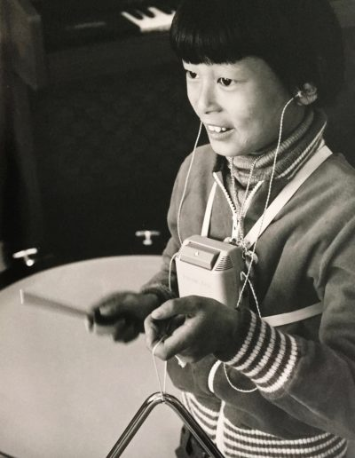 Deaf boy making music (Photo: Ezra Rachlin)